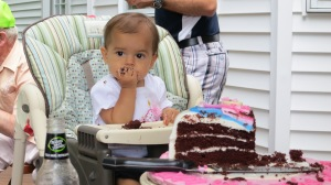 Mallory enjoying her cake while I opened her gifts.